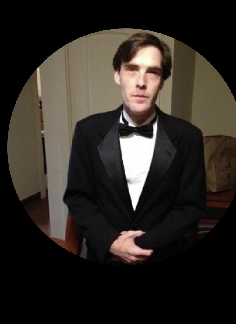 Upper body shot of Aaron Linson in a black tuxedo