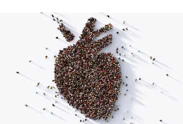 A large crowd of people forming a human heart symbol