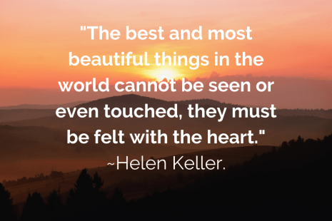 A golden sunrise on a mountainous landscape with Helen Keller's quote: The best and most beautiful things in the world cannot be seen or even touched, they must be felt with the heart.