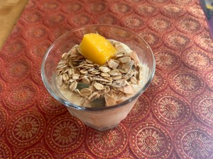 """The Ultimate Smoothie Template: Alicia Connor's """"Mango Lassi"""" Smoothie, topped with a couple of tablespoons of """"no-sugar-added granola"""" (contents: toasted oats & coconut, raw pumpkin seeds, and cinnamon) and a piece of fresh mango."""