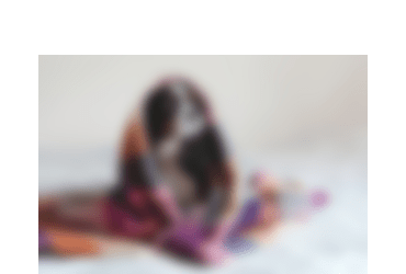 The header is a blurred photo of a cute dog sitting under a blanket. This is only one representation of what low vision can be like for some people. It presents differently in everyone as Libby said in her interview.
