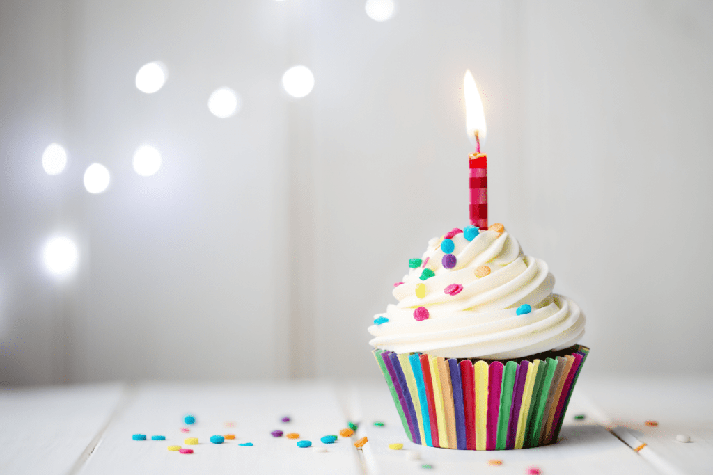 Candles Of Wisdom: A closeup of a cupcake with a single candle.