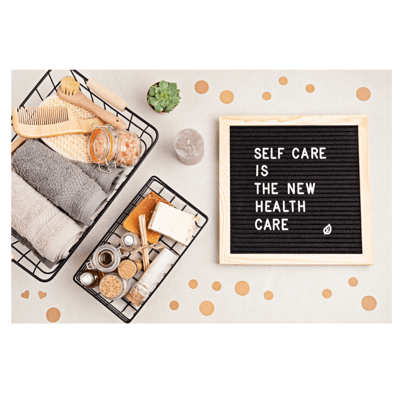 Self care is the new health care. Motivational quote on a black letter board with a variety of organic body and face care products.