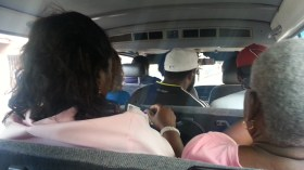 Roughly 15 people including the driver can fit in a mini-bus