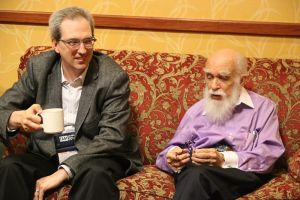 "David Gorski and James Randi sitting on a love seat together at the 2014 ""Amazing Meeting"" - Photo by Susan Gerbic."