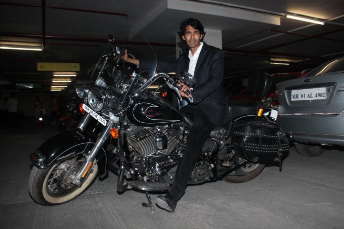Sandeep Mohan (Director) posing with Harley Davidson at the premiere of 'Love, Wrinkle-Free' at PVR, Phoenix.