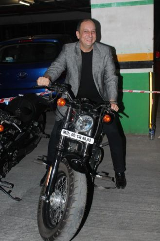 Sohrab Adeshir posing with Harley Davidson at the premiere of 'Love, Wrinkle-Free' at PVR, Phoenix.