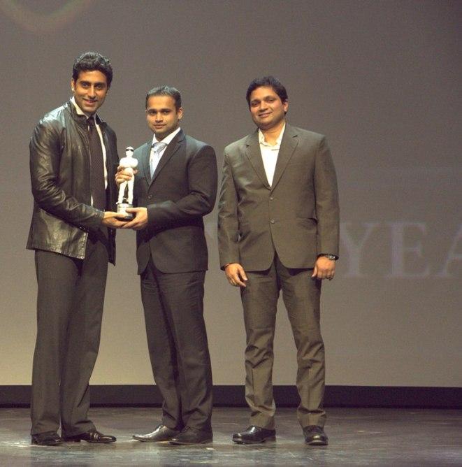 Abhishek Bachchan giving awards to the winner & Girish Karkera (Editor, TopGear Magazine) at 'The TopGear India Magazine Awards 2012'
