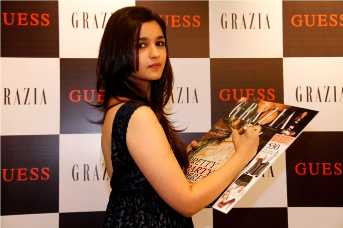 Alia Bhatt signing the Grazia Cover after the launch of the Magazin