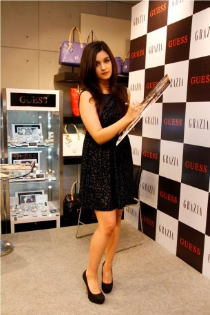Alia Bhatt signing the Grazia Cover after the launch of the Magazin.