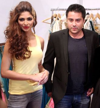 Former Miss India World Parvathy Omanakuttan with Mr. Waahiid Ali Khan (Businessman) at the finale show of designer Karan Raj's at 'Fashion Me 2013' in Dubai