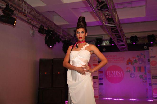 Model walking the ramp at fashion show at the 'Femina Carnival 2013' at Hyatt Regency, Pune.,