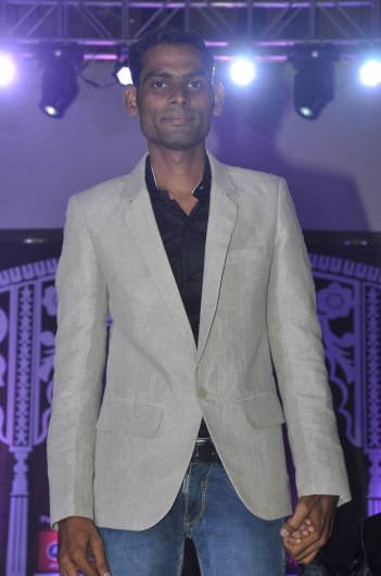 Mr. Ravindra (Director - IWC) walked the ramp with his son at the 'Indian Wedding Couture'.1