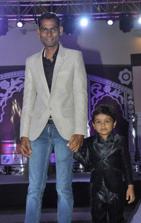 Mr. Ravindra (Director - IWC) walked the ramp with his son at the 'Indian Wedding Couture'.2