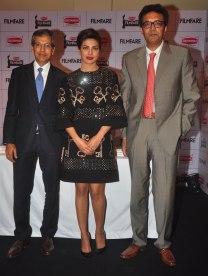 Mr. Tarun Rai (CEO, WWM), Priyanka Chopra & Mr. Varun Berry (MD, Britannia Industries) at the Press Conference of '60th Britannia Filmfare Awards 2014' at JW Marriot.
