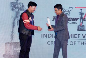 Celebrity Cricketer Sanjay Manjrekar presenting Cruiser of the Year to Indian Chief Vintage at 7th TopGear Awards