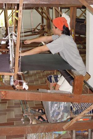 woman-working-silk-loom