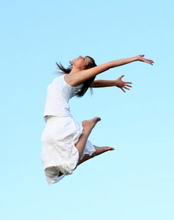 woman-in-white-dress-leaping-in-sky