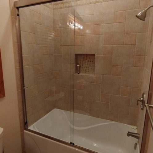 white tub with beige shower
