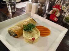 Mushroom Spinach and Goat Cheese Phylo Lasagna with Paprika Sauce and Pomegranate Cous Cous