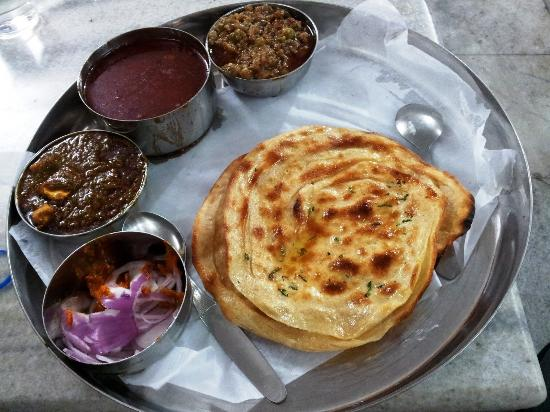 Delicious Paratha Thali with Veggies at Kesar Da Dhaba
