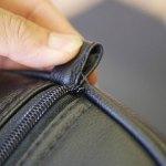 (J.LINDBERG)Jリンドバーグ / キャディバッグフードカバーのファスナーエンドほつれ(J.LINDBERG)Jリンドバーグ / キャディバッグフードカバーのファスナーエンド縫製のほつれ修理