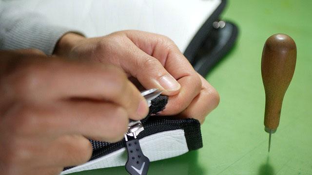 (Callaway)キャロウェイ / キャディバッグフードカバーのファスナーエンドの縫製を解く
