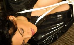 Awesome Brunette in PVC Gets Tape Gagged and Tightly Bound at Home