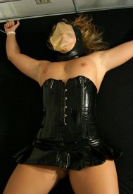 Awesome Slave in Transparent Hood and PVC Gets Restrained on the Bed