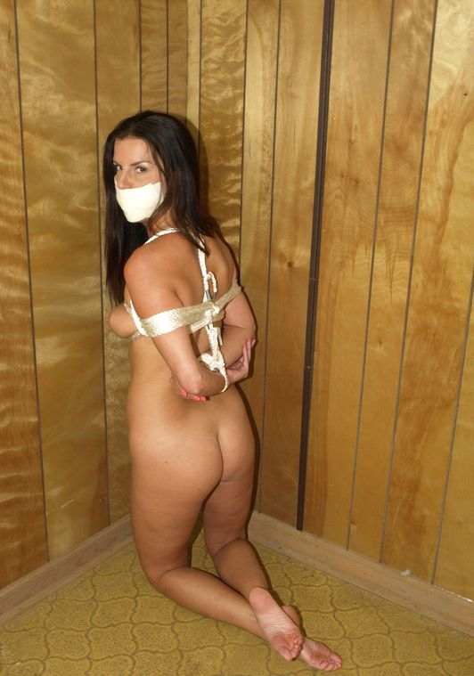 Beautiful Young Brunette Gets Tightly Bound and Tape Gagged for Fun
