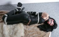 Beautiful Young Brunette in Leather Ball Gagged, Collared and Hogtied