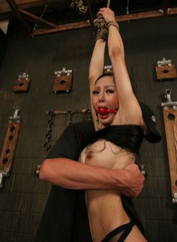 Busty Petite Asian Ball Gagged, Restrained and Punished in the Dungeon