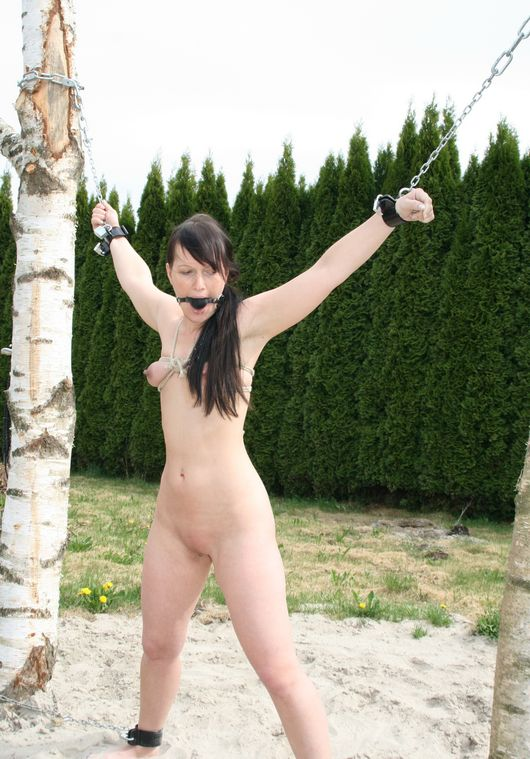 Cute Young Brunette Gets Bound and Chained Outside for Punishment