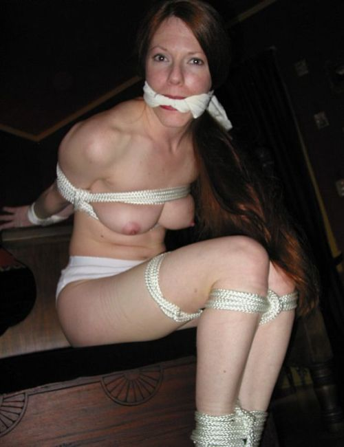 Gorgeous Redhead Tightly Bound and Cleave Gagged in Hotel Room