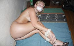 Gorgeous Young Blonde in High Heels Gets Tape Gagged and Bound for Fun