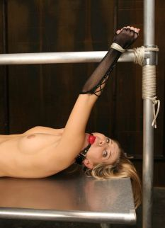 Hot Blonde in Garters and Gloves Gagged and Punished in the Dungeon