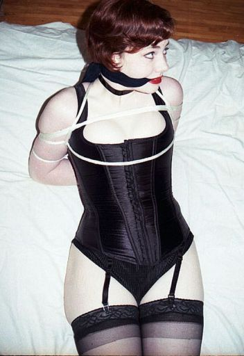 Hot Redhead in Corset and Garters Cleave Gagged and Hogtied for Fun