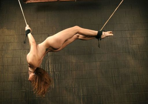 Hot Young Brunette Gets Suspended and Punished Hard in Dungeon