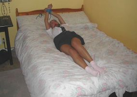 Kinky Schoolgirl Gets Bound and Ball Gagged on Bed for Discipline