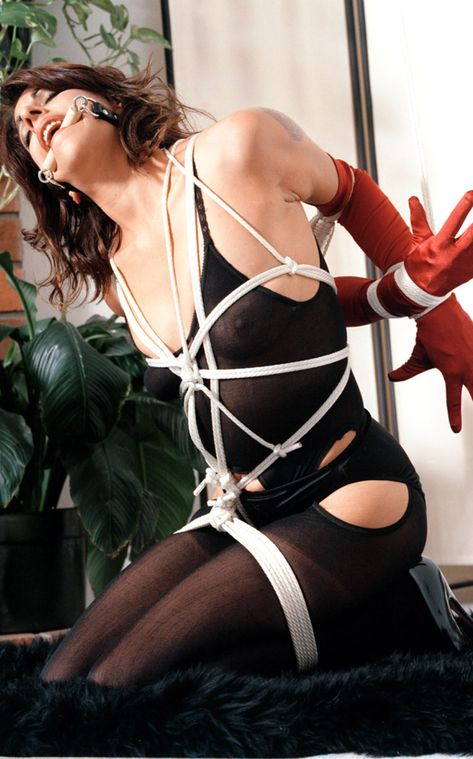 Sexy Brunette in Gloves and High Heels Bit Gagged and Tightly Bound