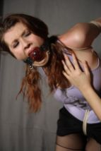 Sexy Brunette Slave Bound and Ball Gagged by Her Mistress in Corset