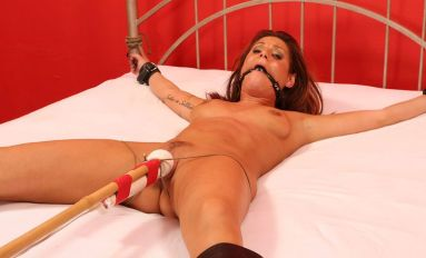 Sexy Slave in Boots Gets Restrained, Gagged and Tortured on the Bed