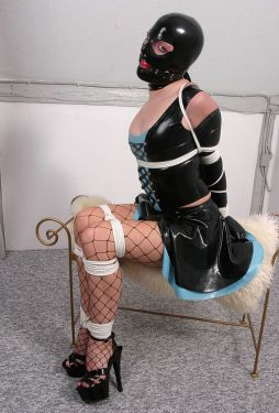 Sexy Slave in Latex and High Heels Gets Tightly Bound and Gagged