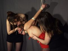 Sexy Slave Tightly Bound and Ball Gagged by Two Gorgeous Mistresses