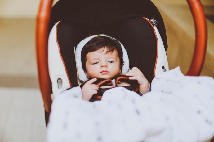 newborn baby boy in maxi cosi rachel zoe car seat