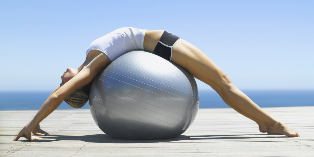 Woman working out with an exercise ball