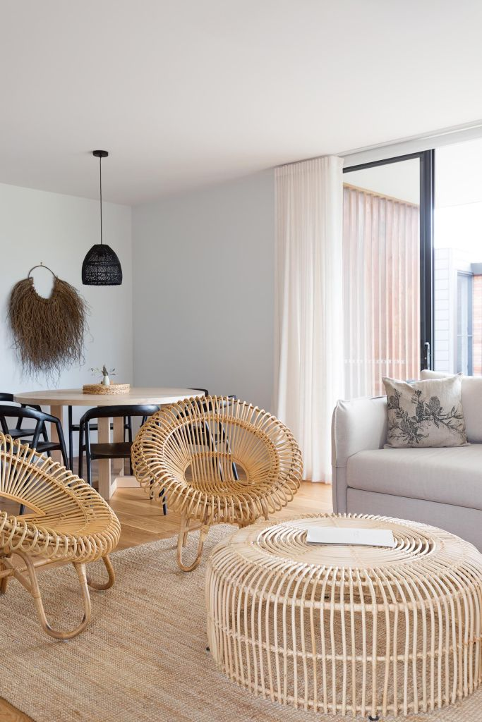 Room in seaside hotel in NSW with cane chairs and white interiors