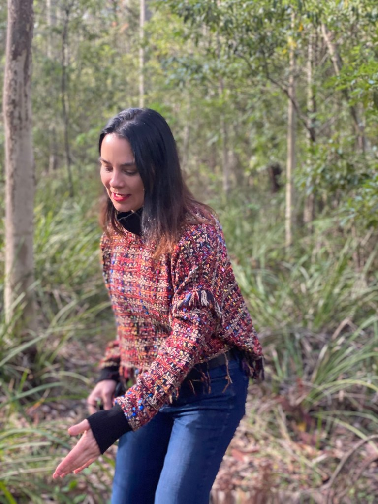woman in red top and blue jeans in the Australian Outback.