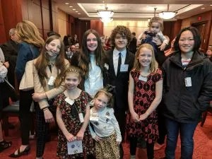 Gaten Matarazzo poses with Ear Community kids for Advocacy Day 2019.