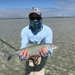 Man with bonefish